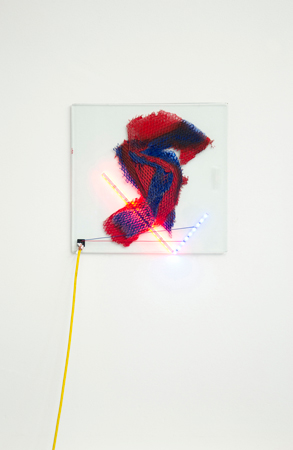 Red and Blue Composition, a collaborative work by Gaia Fugazza and Haroon Mirza shown at the Tinguely Museum, Basel.  Glass, fishing nets, LED lights